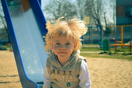 photo of child near slide