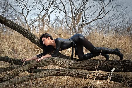 woman wearing black leather bodycon dress