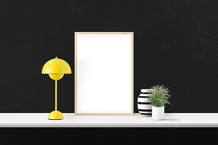 yellow table lamp turned off on desk
