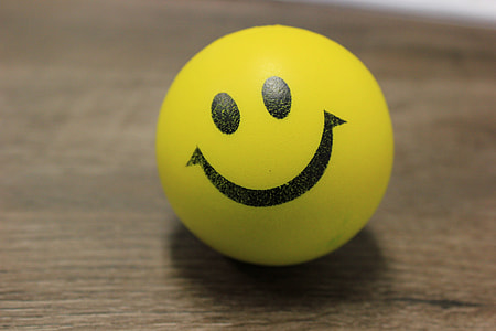 smiley ball on brown wooden surface
