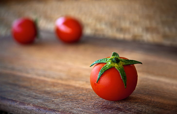 red tomato fruit on brown surface