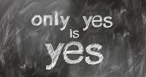 only yes is yes text on black background