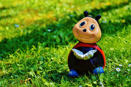 ladybug character toy on grass at daytime photo