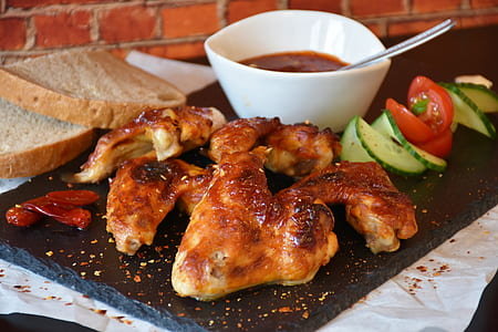grilled chicken with sauce and bread dish