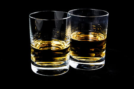 two clear glass shot glasses