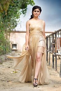 woman wearing brown one-shoulder dress