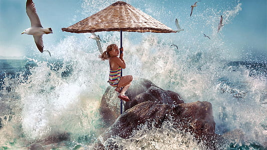photo of woman holding patio umbrella with sea wave and flying sea birds