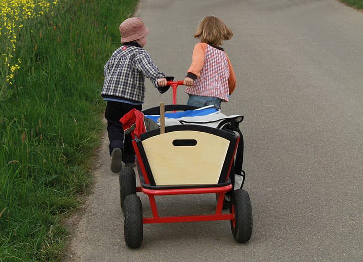 two children pulling wagon