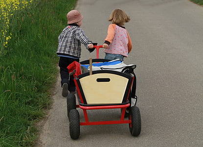 two children pulling wagon