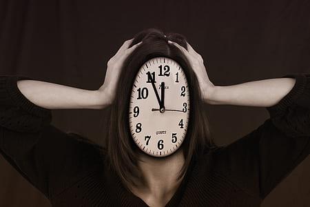 photography of white analog clock