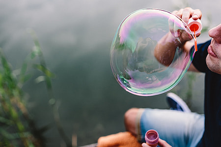 Having fun with soap bubbles in the nature