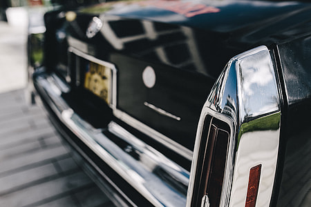 Close up of antique black and chrome Cadillac car