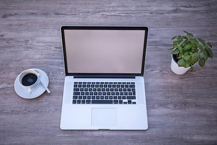 Royalty-Free photo: MAcBook Pro beside coffee mug   PickPik