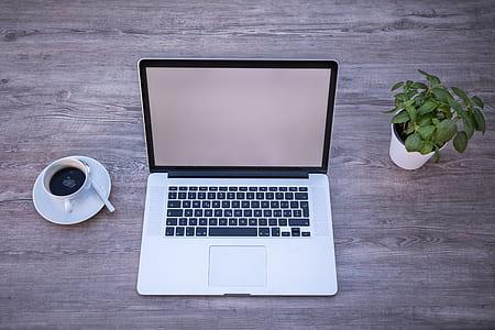 MAcBook Pro beside coffee mug