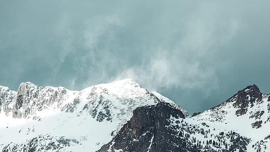 rocky mountain under white ky