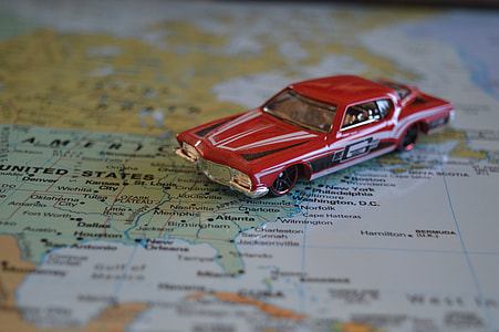 red die-cast coupe on map