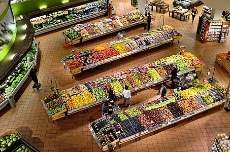 aerial view of people buying fruits display