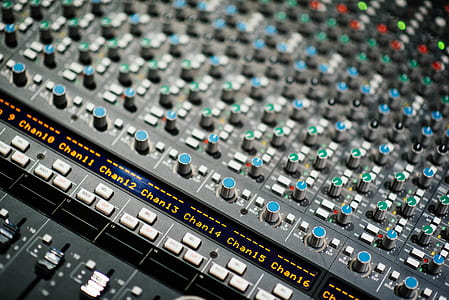 shallow focus photo of gray and blue audio mixer