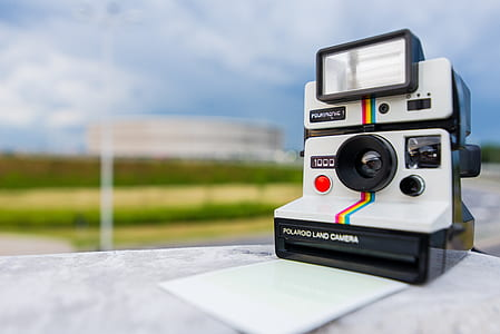 Tilt Shift Photography of Polaroid Land Camera on White Table