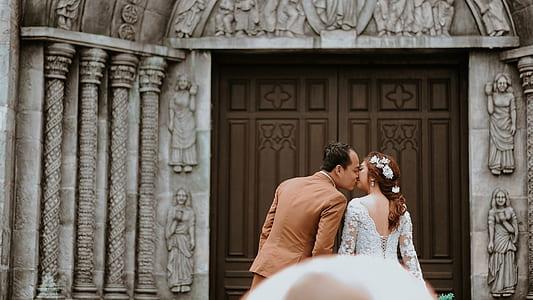 Couple Near on Wooden Sash Door