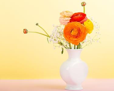 assorted-color petaled flower arrangement in vase