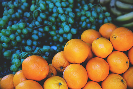 A fruit stall selling oranges and grapes, image captured in Paris, France with a Canon 6D DSLR