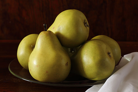 bunch of green pears on green plate