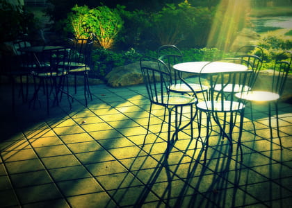 patio tables and chairs on gray concrete pavement
