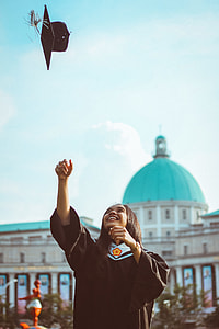 woman tossing her graduation hat