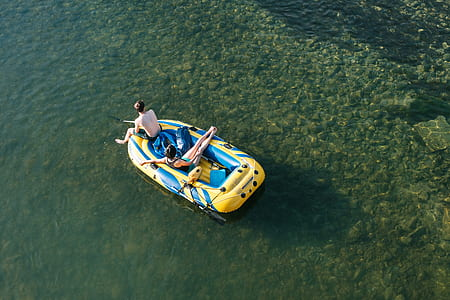 two man on fishing on inflatable boat
