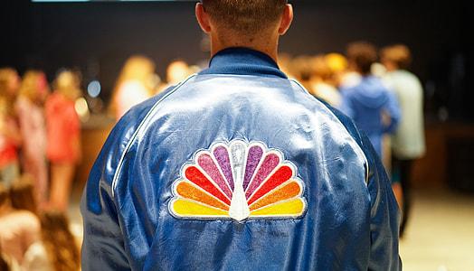 man wearing blue leather jacket