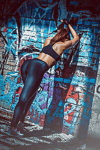 woman wearing black sports bra and black leggings