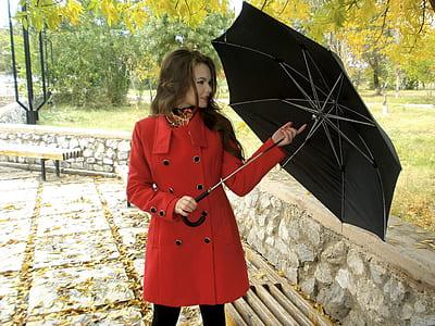 woman holding umbrella facing right