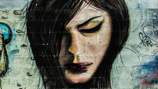 woman portrait wall graffiti