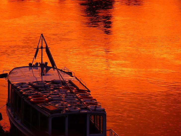 boat on rippling orange water