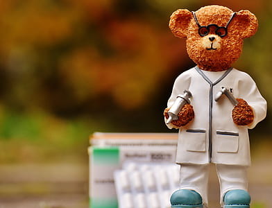 focus photo of doctor bear figurine