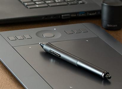 grey stylus pen on trackpad