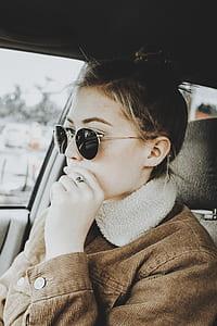 woman wearing brown corduroy jacket