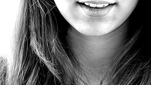 grayscale photography of woman sticking her mouth open