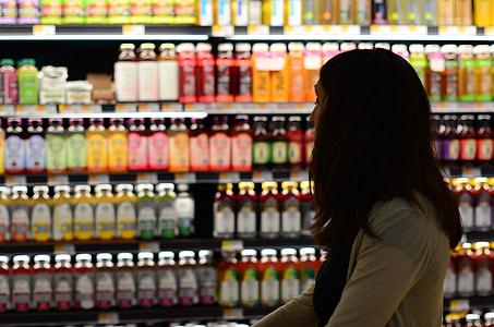 woman looking at assorted beverage displays