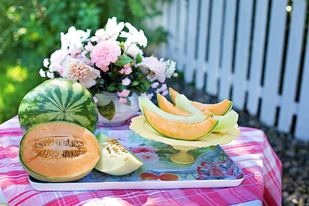 sliced melon and watermelon fruits on beige tray
