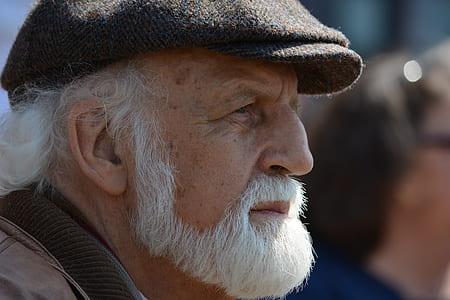 man wearing black newsboy cap