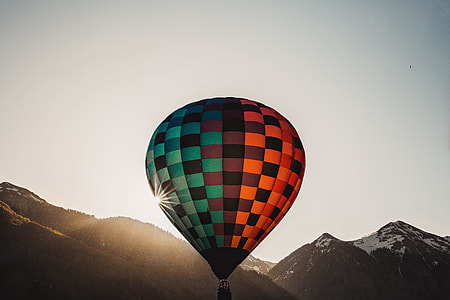 red, brown, and teal hot air balloon