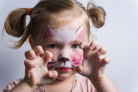 girl with face paint showing cat claws