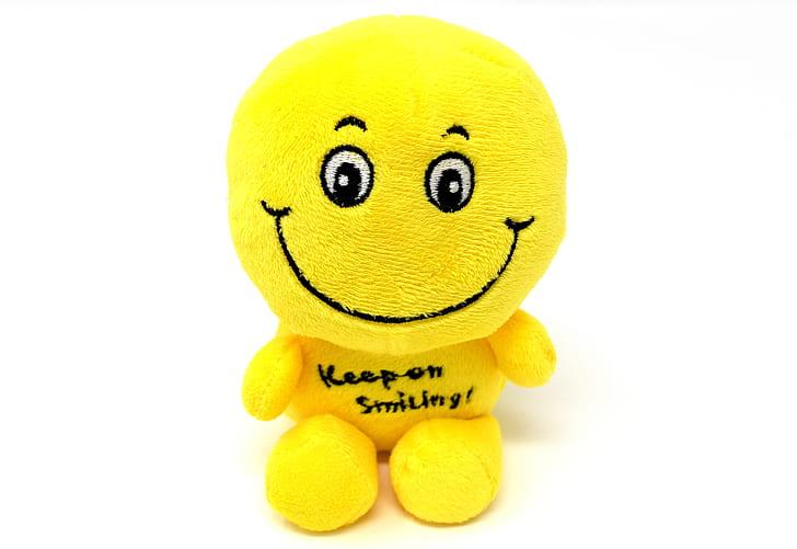 yellow smiley plush toy