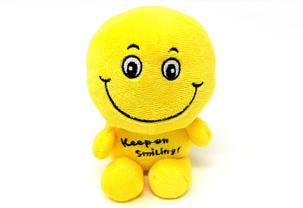 yellow smiley plush toy