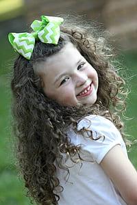 girl in white shirt smiling