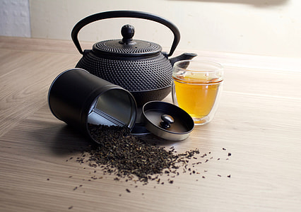 teapot near can of tea photography
