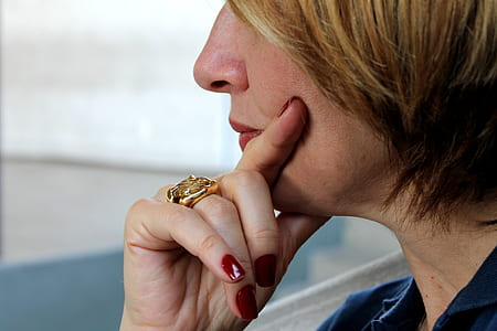 woman wearing gold-colored ring