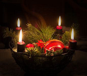 red lighted candles on mesh basket